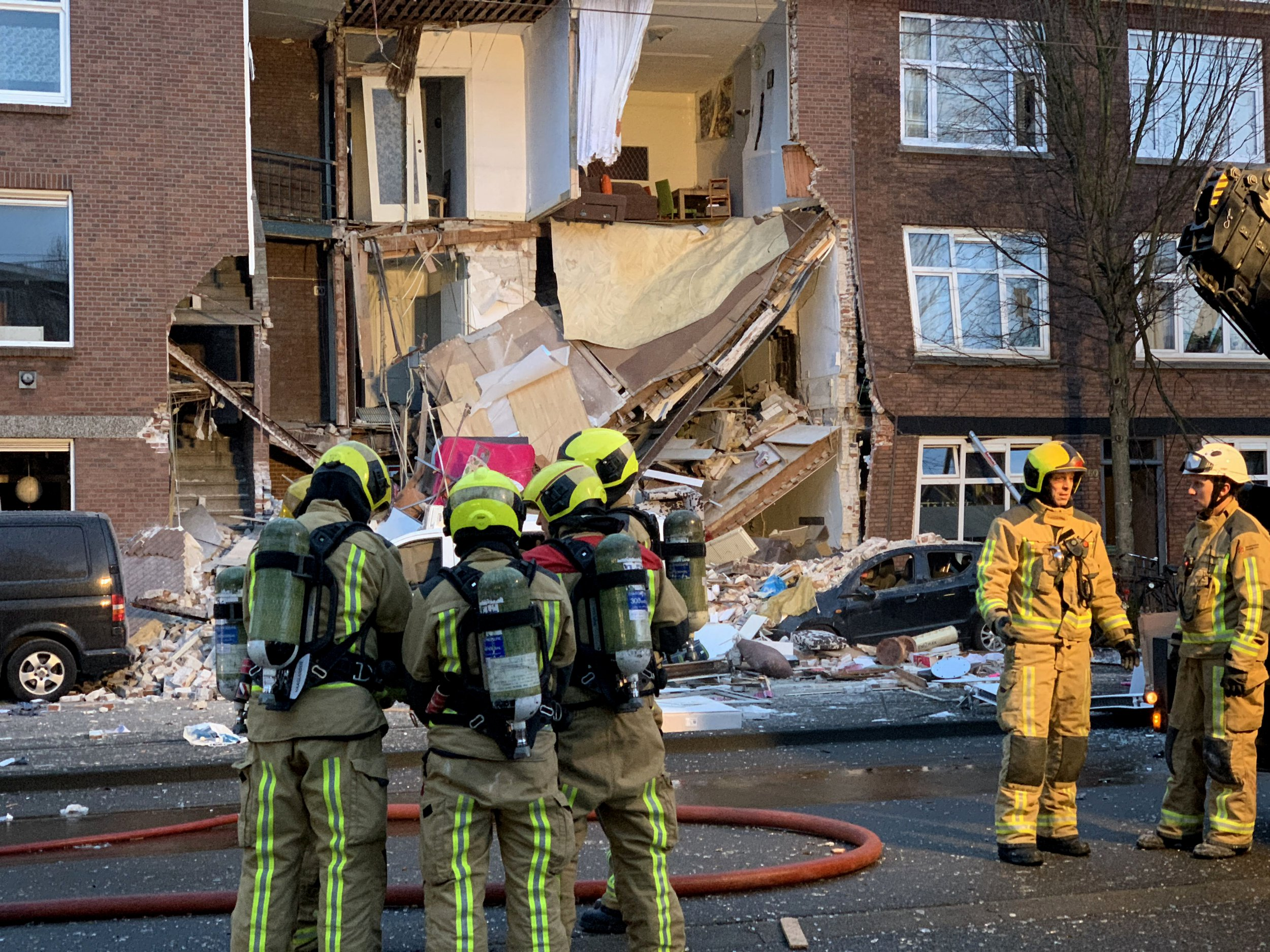 Authorities respond after a three-story home collapsed in The Hague, Netherlands on Sunday, Jan. 27, 2019. Police at the scene said a gas explosion was being explored as a possible cause of what tore off the home's front and demolished the dwelling in a residential neighborhood on Sunday. (AP Photo/Wong Maye-E)