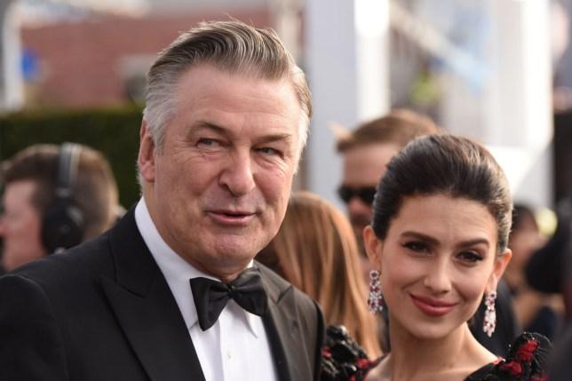 Actor Alec Baldwin (L) and wife Hilaria Baldwin walk the red carpet at the 25th Annual Screen Actors Guild Awards at the Shrine Auditorium in Los Angeles on January 27, 2019. (Photo by Robyn Beck / AFP)ROBYN BECK/AFP/Getty Images