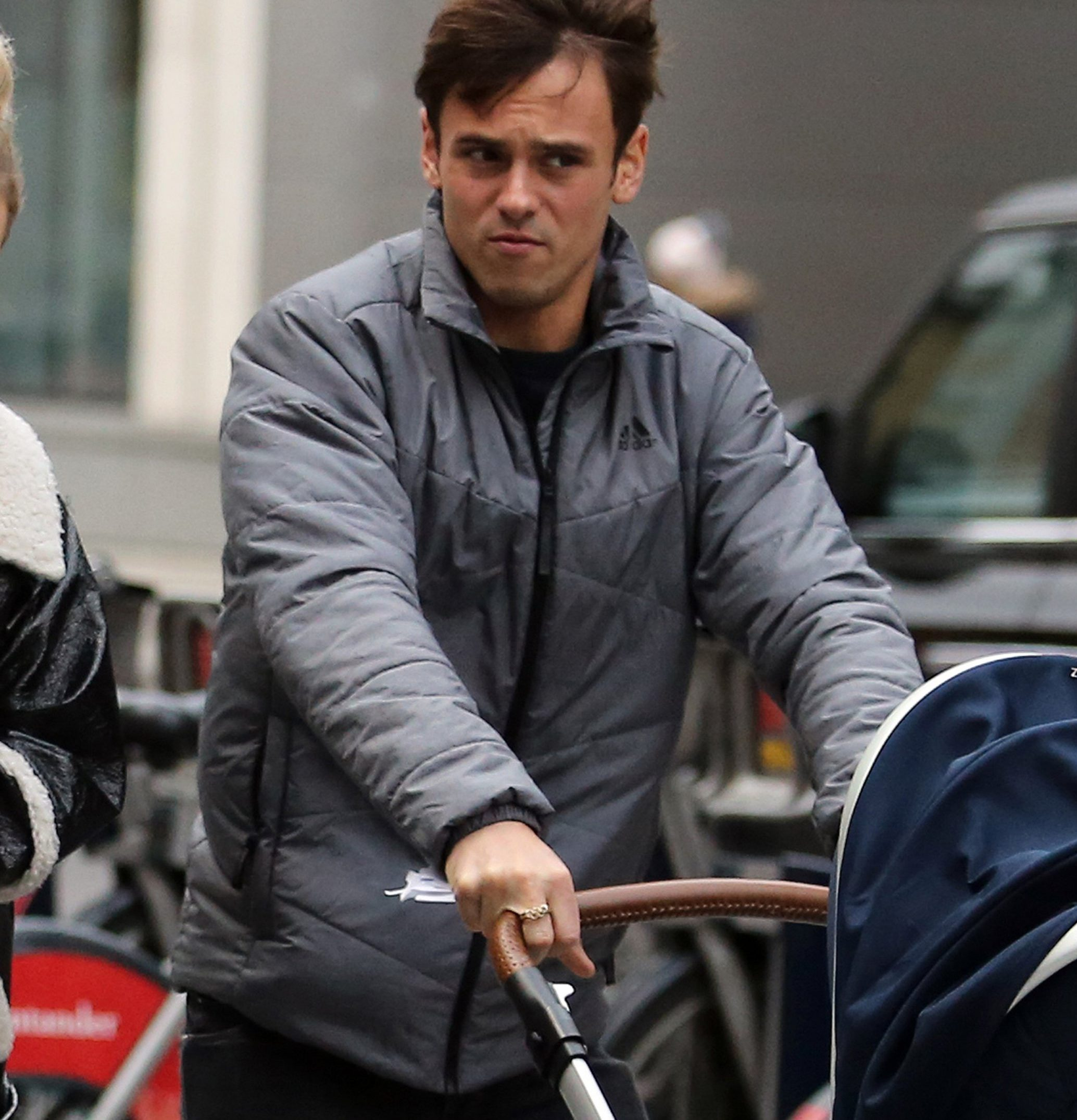 EXCLUSIVE: * Online Set Fee 200 GBP * *UK Print Min Fee 150 GBP Per Pic - Double Fees Page 1 * British Athlete Tom Daley spotted pushing his baby Robert Ray around central London at the weekend. The Olympic diver was joined by two friends, and looked every inch the doting Dad as he pushed his son in a ??500 Joolz stroller. Pictured: Tom Daley Ref: SPL5058745 260119 EXCLUSIVE Picture by: SplashNews.com * Online Set Fee 200 GBP * *UK Print Min Fee 150 GBP Per Pic - Double Fees Page 1 * Splash News and Pictures Los Angeles: 310-821-2666 New York: 212-619-2666 London: 0207 644 7656 Milan: 02 4399 8577 photodesk@splashnews.com World Rights