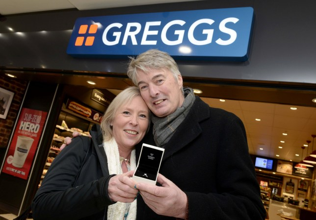 PIC FROM Caters News - (PICTURED: Nick Sawyer and Carolyn Bennett from Wolverhampton) - A lovestruck postman decided to pop the question to his bride-to-be in their local Greggs. Nick Sawyer proposed to heartthrob of two years Carolyn Bennett in a branch of the discount bakery in Wolverhampton, West Mids, while the couple were enjoying a cuppa and a sausage roll on Sunday (Jan 27).SEE CATERS COPY