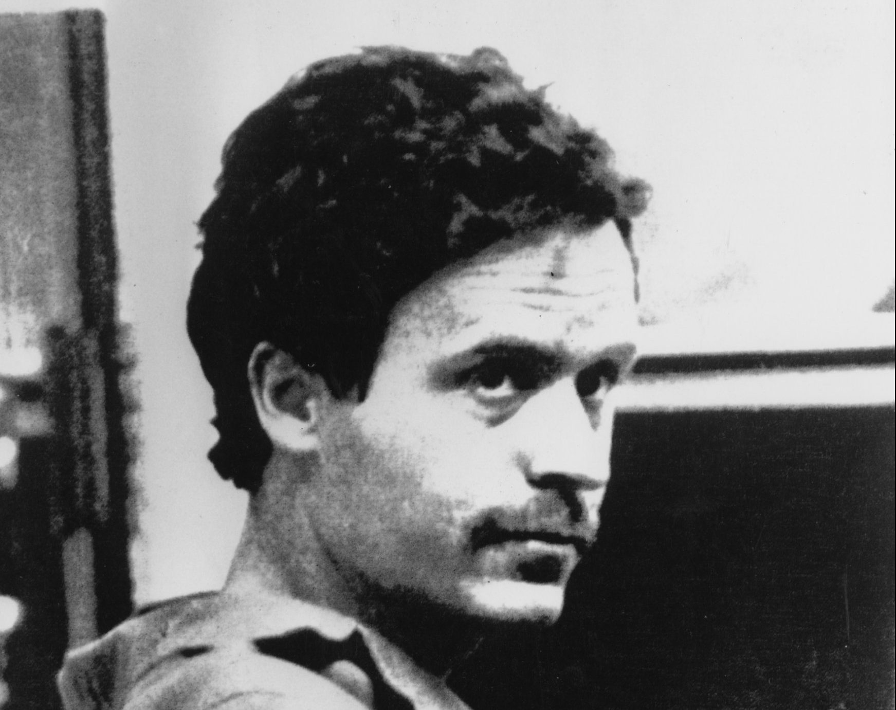 American serial killer Ted Bundy (1946 - 1989) at the Leon County sheriff's office in Florida, shortly after after his arrest on a charge of theft, 19th February 1978. He later confessed to over thirty murders and was executed in 1989. (Photo by Donn Dughi/Bride Lane Library/Popperfoto/Getty Images)