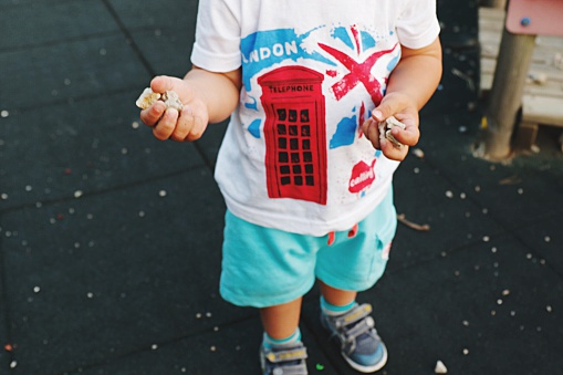 A child wearing a t-shirt with a British flag and red telephone box on it