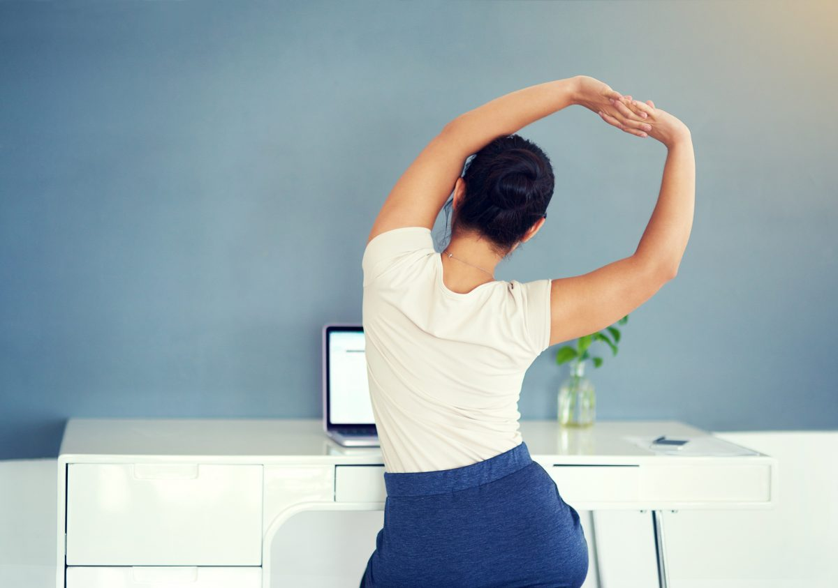 Alleviate back pain by doing these stretches at your desk