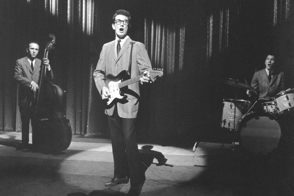Buddy Holly performing on stage