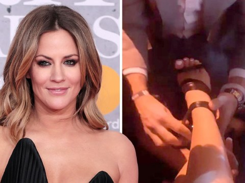 Caroline Flack cry-laughs as she's forced to gaffer tape shoe together at Brit Awards