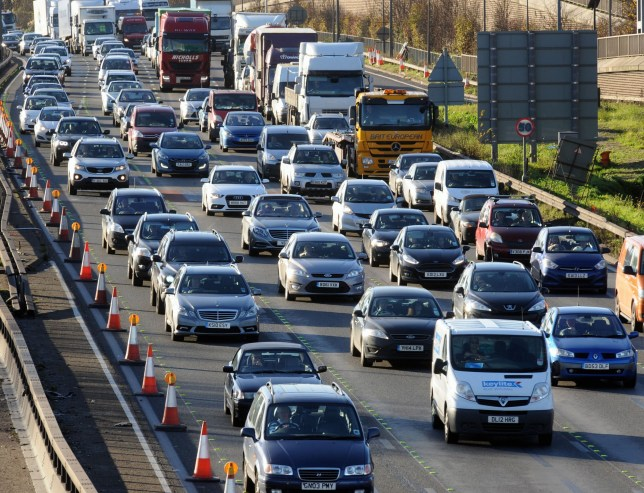 Cars and trucks in traffic on a motorway