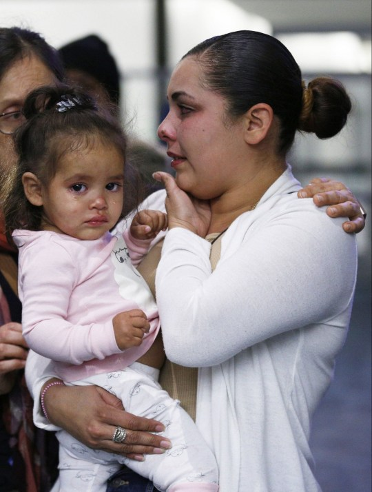 "January 29, 2019 - San Francisco, California, United States: Sindy Flores is reunited with her daughter Juliet at San Francisco International Airport. The Honduran mother is pursuing her asylum claim in San Francisco. Her 17-month-old daughter Juliet was held at a Texas shelter for a month, when she was separated from her father attempting to cross the U.S.-Mexico border. The baby, Juliet, was sent to a shelter for migrant children in Texas after immigration officials took her from her father, Kevin Ventura-Corrales, whom they arrested Dec. 28 near Calexico. He is still being detained by U.S. Immigration and Customs Enforcement in Arizona. The 23-year-old mother said that the federal government kept adding requirements for the child's release, including a credit card payment of up to $4,000 to fly the girl to San Francisco with a care provider. Thousands of children were separated from their parents last year under Trump's ""zero tolerance"" policy, which criminally prosecuted anyone who illegally crossed the border. Children accompanying parents or other adults on the journey were put in shelters or foster care under the Department of Health and Human Services' Office of Refugee Resettlement. (Santiago Mejia / San Francisco Chronicle / Polaris) Credit: Polaris / eyevine For further information please contact eyevine tel: +44 (0) 20 8709 8709 e-mail: info@eyevine.com www.eyevine.com"