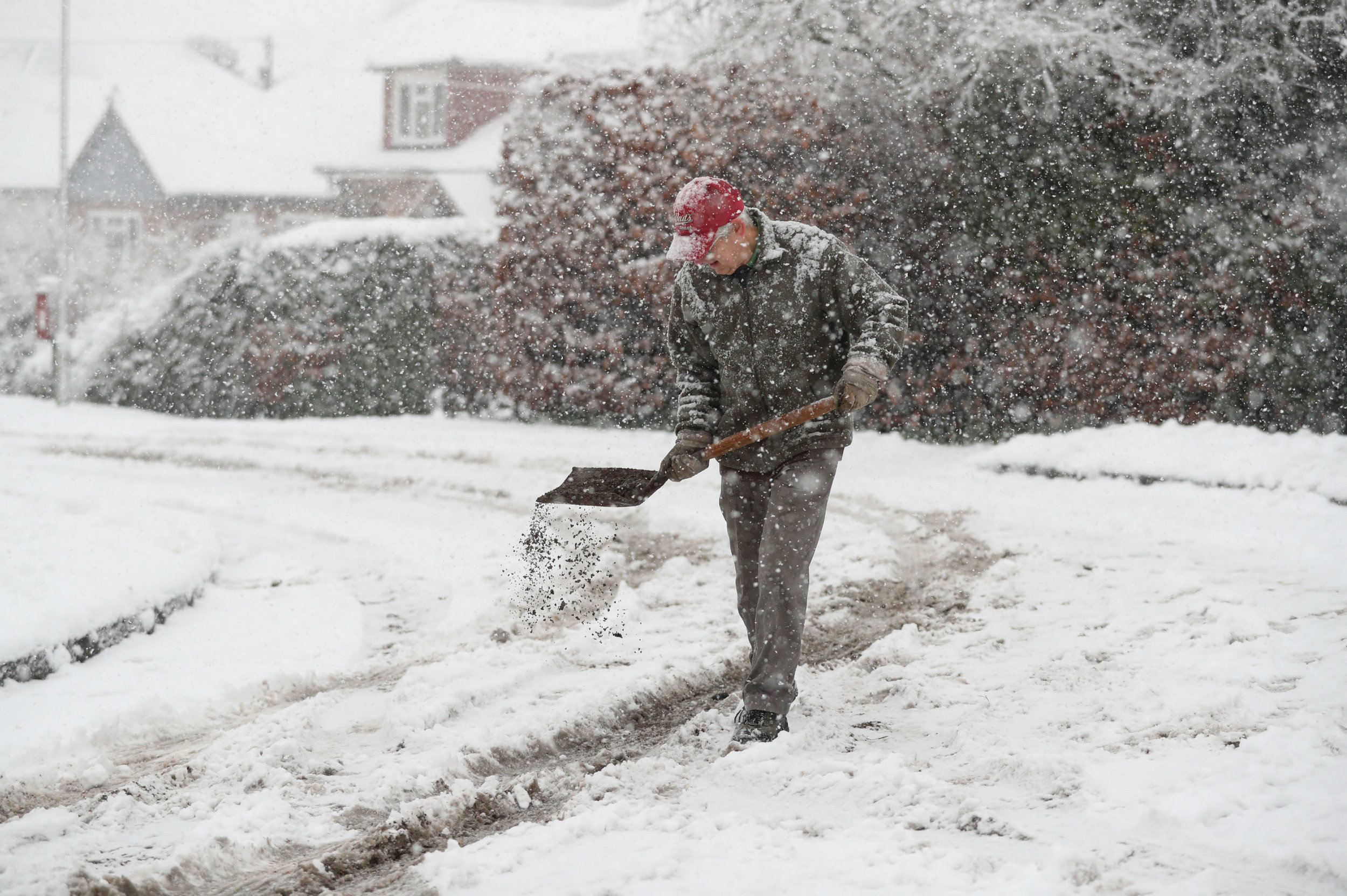 A local resident grits his road in Basingstoke, Hampshire. PRESS ASSOCIATION Photo. Picture date: Friday February 1, 2019. See PA story WEATHER Snow. Photo credit should read: Andrew Matthews/PA Wire