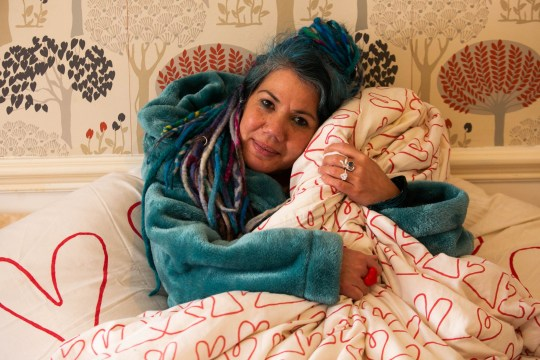 "Pascale Sellick from Exeter, Devon, with her duvet which she plans to marry next month. See SWNS story SWPLduvet; A woman who plans to marry her duvet has revealed she got cold feet after becoming known as the 'duvet lady'. Pascale Sellick, 49, went viral last month when she announced plans to marry her duvet, as it was the ""most intimate and reliable relationship"" she had ever had. But the artist, from Exeter, Devon, was shocked by becoming an internet celebrity and now has doubts about the unusual ceremony. But for now plans are still going ahead, and Pascale and her duvet are due to be wed on Sunday, February 10, at 2pm."
