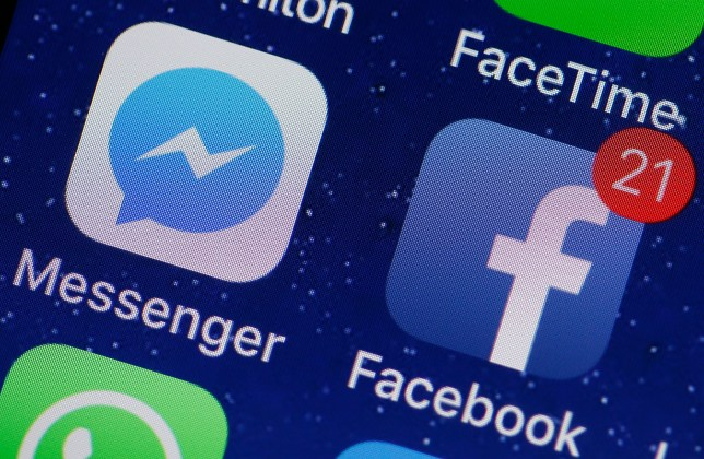 PARIS, FRANCE - APRIL 06: In this photo illustration, the logo of the Messenger and Facebook applications are displayed on the screen of an Apple iPhone on April 06, 2018 in Paris. In the midst of turmoil following the Cambridge Analytica scandal, Facebook faces a host of questions regarding its privacy and confidentiality practices. Messenger, the messaging application launched by Facebook, is in the center of attention. Indeed, Facebook allows itself to analyze the links and images that users send to Messenger and even to read the messages exchanged if they are posted, in order to make sure that the contents comply with the conditions of use. This increased monitoring of Facebook within its messaging application was confirmed by Mark Zuckerberg a few days ago.(Photo Illustration by Chesnot/Getty Images)