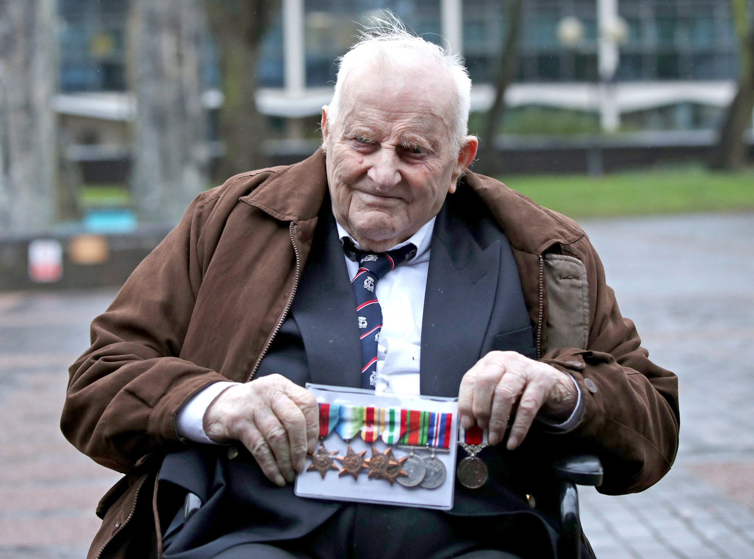 Douglas Meyers, a blind 97-year-old Second World War veteran who is battling to persuade a High Court judge to let him leave a care facility and end his life at home, leaves the court house in Southend after a hearing. PRESS ASSOCIATION Photo. Picture date: Monday February 4, 2019. The former Royal Navy gunner, who served in the Italian and north African theatres during the 1940s, arrived at the hearing in a wheelchair and sat at the front of the court wearing a row of campaign medals. See PA story COURTS Gunner. Photo credit should read: Yui Mok/PA Wire