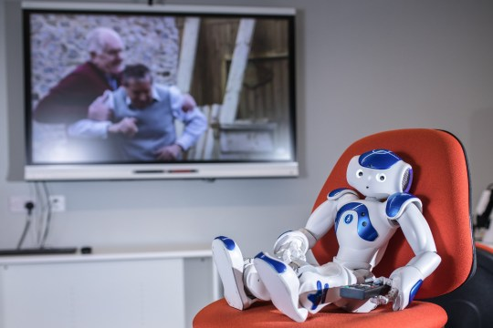 MERCURY PRESS. 05/02/19. Ormskirk, UK. Pictured: Robbie the Robot, a university robot that has been watching Emmerdale in order to be taught about dementia and help people suffering from it in the future. A soap addicted robot is set to help dementia patients by binge watching hit comedy Friends and popular soap Emmerdale. Robbie the Robot - who took two years to build by a university lecturer and his students - is thought to be the first of its kind. After being completed this year, Robbie has spent the last few weeks watching 13 episodes of the soap, Emmerdale, in a bid to help him recognise different facial expressions and body language. SEE MERCURY COPY. Photo Credit: James Speakman/Mercury Press
