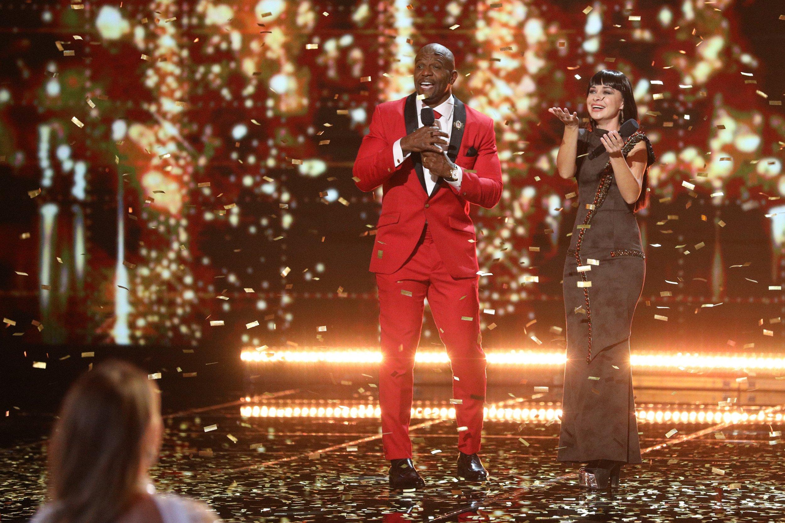 terry crews, host of america's got talent the champions, and contestant Kseniya Simonova