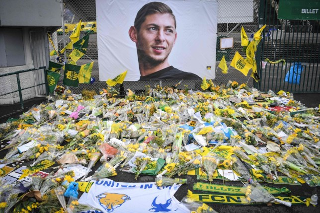 Yellow flowers are displayed in front of the portrait of Argentinian forward Emiliano Sala at the Beaujoire stadium in Nantes, on February 8, 2019.
