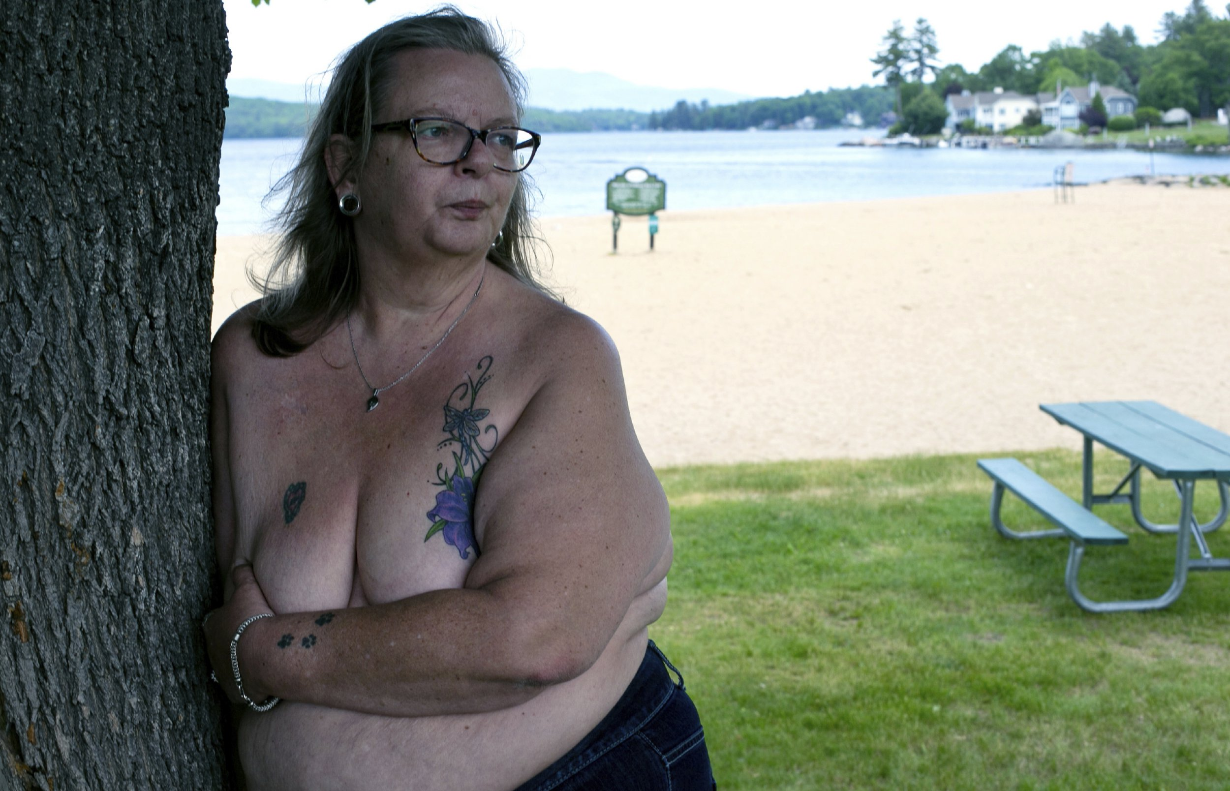 FILE - In this June 2, 2016 file photo, Heidi Lilley stands for a portrait near the spot where she was arrested by the Laconia, N.H. police. On Friday, Feb. 8, 2019, New Hampshire's highest court has upheld the conviction of three women arrested for going topless on a New Hampshire beach. In a 3-2 ruling, the court found Laconia's ordinance does not discriminate on the basis of gender or violate the women's right to free speech. (Geoff Forester/The Concord Monitor via AP)