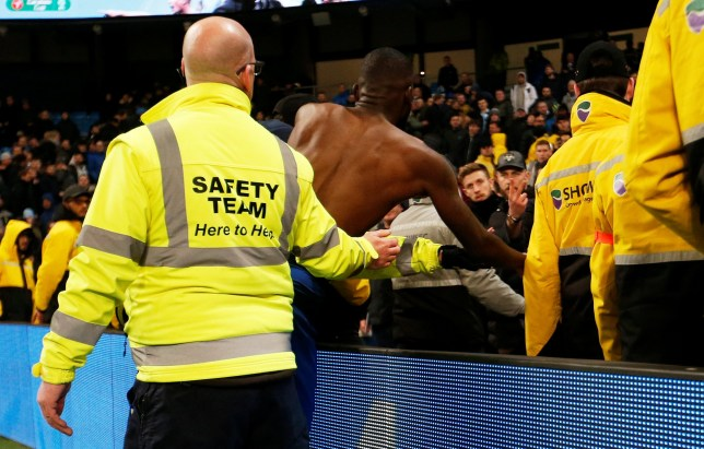 A fan gestures to Chelsea's Antonio Rudiger after Chelsea's defeat to Man City