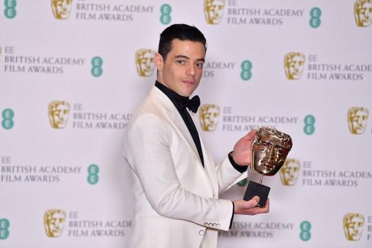 Rami Malek poses with his Bafta award for Freddie Mercury role in Bohemian Rhapsody