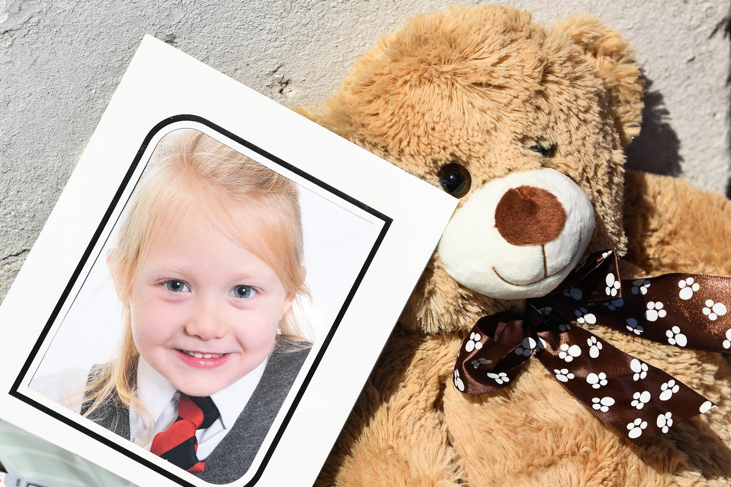ROTHESAY, ISLE OF BUTE, SCOTLAND - JULY 04: A school picture of Alesha MacPhail is left at a house on Ardbeg road on July 4, 2018 in Rothesay, Isle of Bute, Scotland.The case has become a murder inquiry yesterday evening following the post-mortem examination on the six year old, police have yet to confirm how she died. (Photo by Jeff J Mitchell/Getty Images)