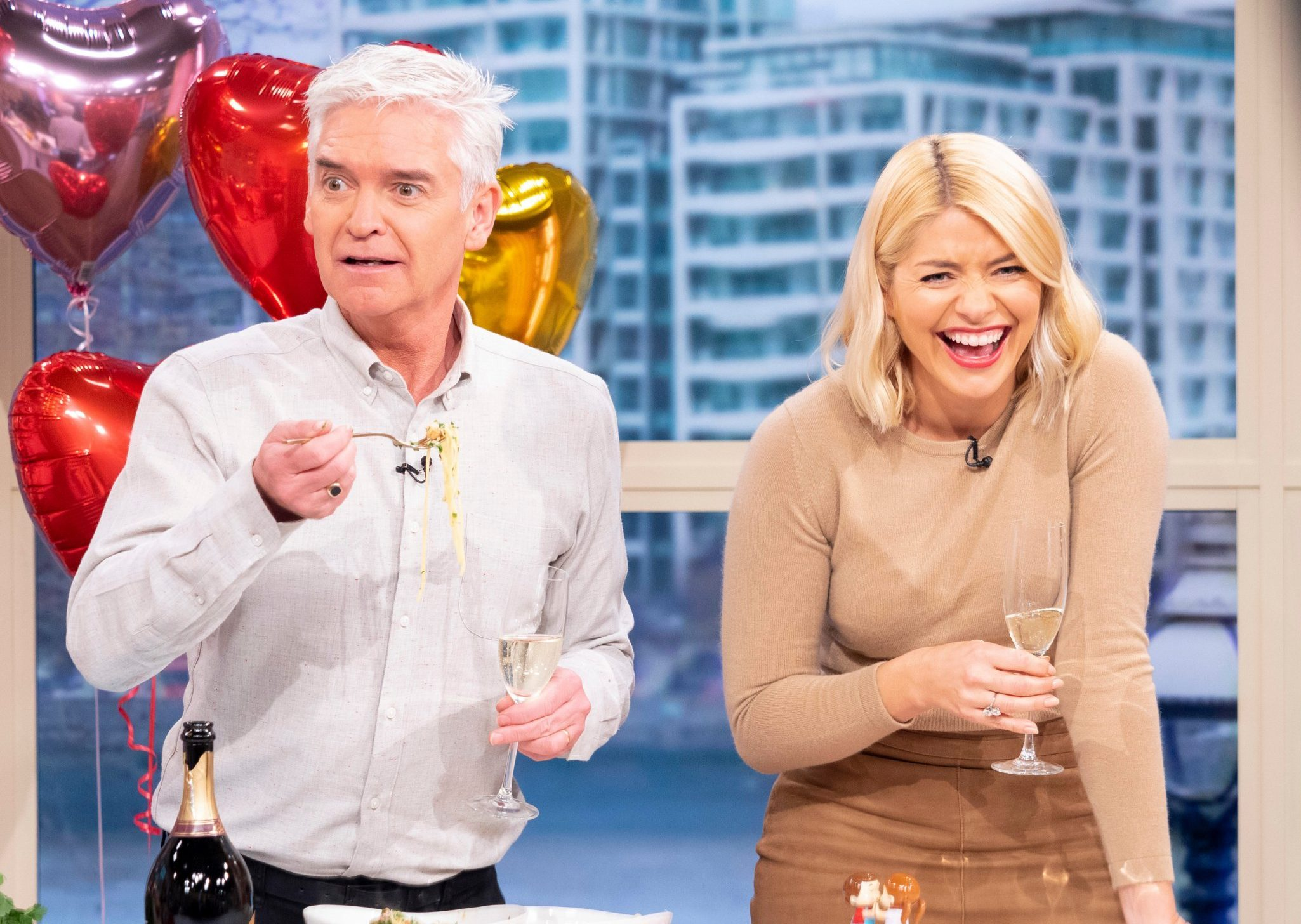 Editorial use only Mandatory Credit: Photo by Ken McKay/ITV/REX (10101385cm) Phillip Schofield and Holly Willoughby 'This Morning' TV show, London, UK - 11 Feb 2019 Holly Willoughby and Phillip Schofield were left in fits of giggles today as they tried their hand at cooking for the first time, when Gino was too unwell to make it to the This Morning studio. Gino had been due in to cook a Valentine?s day special of ?Linguine crab with Prosecco and cherry tomatoes?. Phillip quipped: ?It?s the first time ever Holly and I are cooking on the air by ourselves. We have Julia our home economist upstairs in the gallery and show?s going to jump in if we do anything wrong. And also because we can?t be trusted we have a medic on a standby. Rhonda is there in case were burn ourselves.? Holly and Phillip struggled to stifle their laughter as Gino barked instructions down the line. Gino shouted: ?Stir the pasta! The garlic and chilli is burning! I?m not working, I have a stomach bug.?