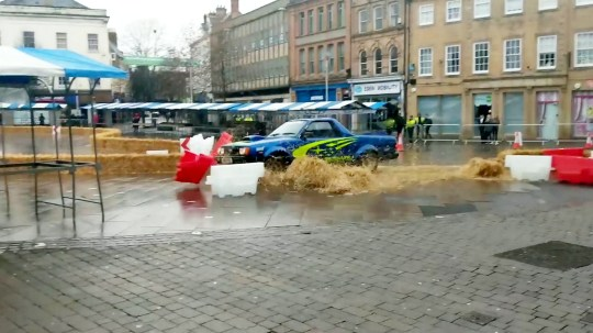 """This is the moment Freddie Flintoff smashed a pick-up truck into a market stall while racing his Top Gear co-hosts around a town centre. See SWNS story SWOCfreddie. The former cricketer was racing Paddy McGuinness and Chris Harris during filming for the 22nd series of Top Gear. But after seemingly misjudging a bend he smashed the retro car straight through a buffer of straw bales and into an empty market stall in Mansfield on Sunday. Onlookers said red-faced Flintoff escaped the customised mid-90s Subaru MV pickup truck without any injuries. A witness, who captured the footage said: """"Reactions were mixed. Some people laughed, others were in a slight shock."""" The footage, captured at 9.50am, shows the trio racing against each other around Mansfield Town Centre whilst testing the pros and cons of electric cars. A council spokesperson confirmed Flintoff was driving the car which crashed. Executive mayor of Mansfield, Kate Allsop, said the team arrived at 3am and had left by 11am."""