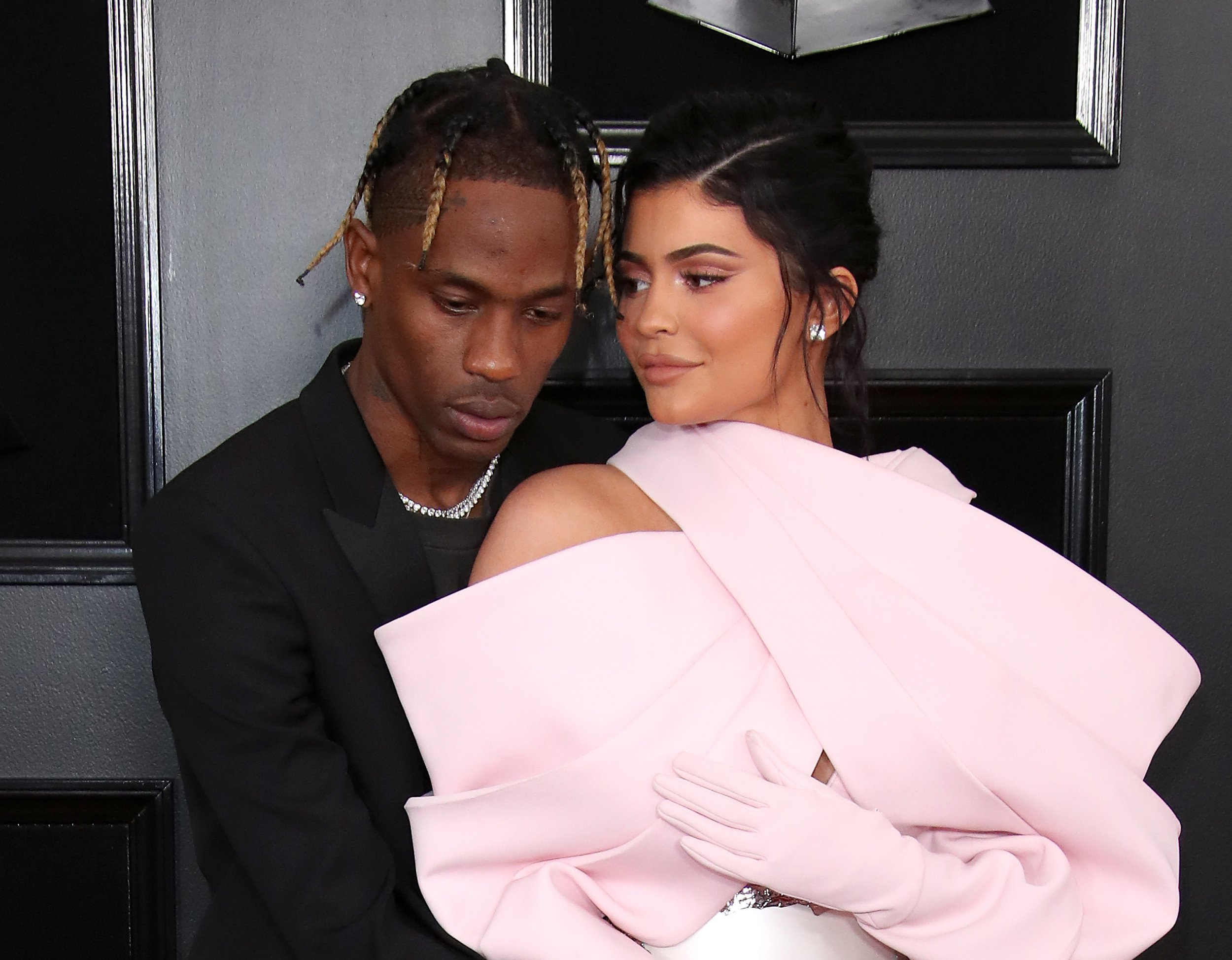 Kylie Jenner finds it 'difficult' when Travis Scott is on tour, but he's doing everything to 'regain her trust'