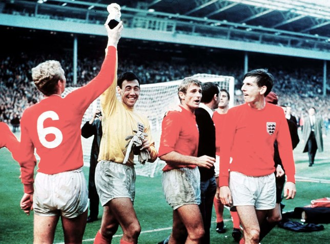 Mandatory Credit: Photo by John Varley/REX/Shutterstock (9628359b) Bobby Moore (L) and Gordon Banks show off the Trophy watched by Hunt and Peters England v Germany, FIFA World Cup Final, Football, Wembley Stadium, London, UK - 30 Jul 1966