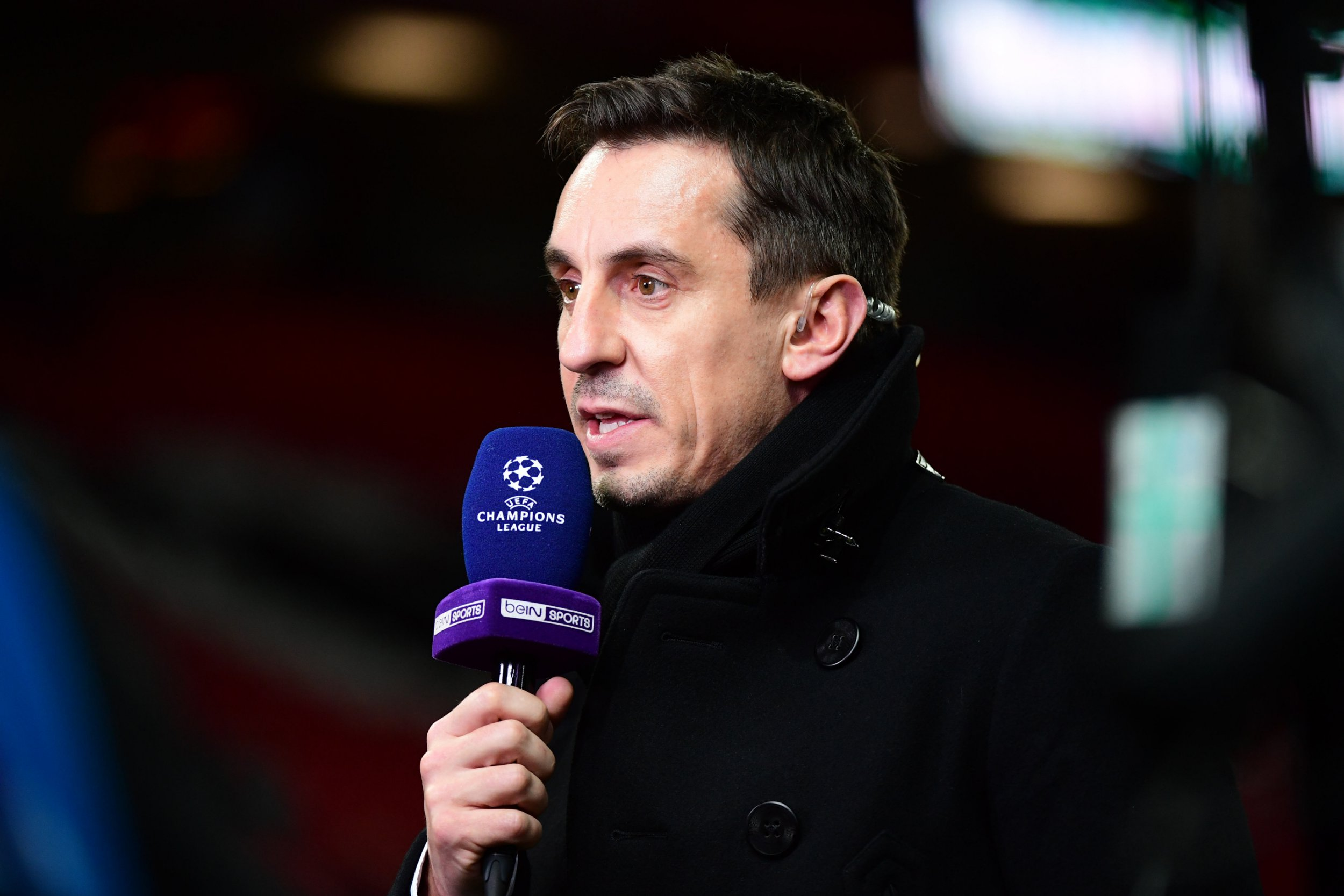 Gary Neville speaking as a pundit during the Champions League Round of 16