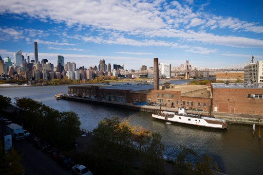 FILE- In this Nov. 7, 2018, file photo, a rusting ferryboat is docked next to an aging industrial warehouse on Long Island City's Anable Basin in the Queens borough of New York. Amazon said Thursday, Feb. 14, 2019, that it is dropping New York City as one of its new headquarter locations. (AP Photo/Mark Lennihan, File)