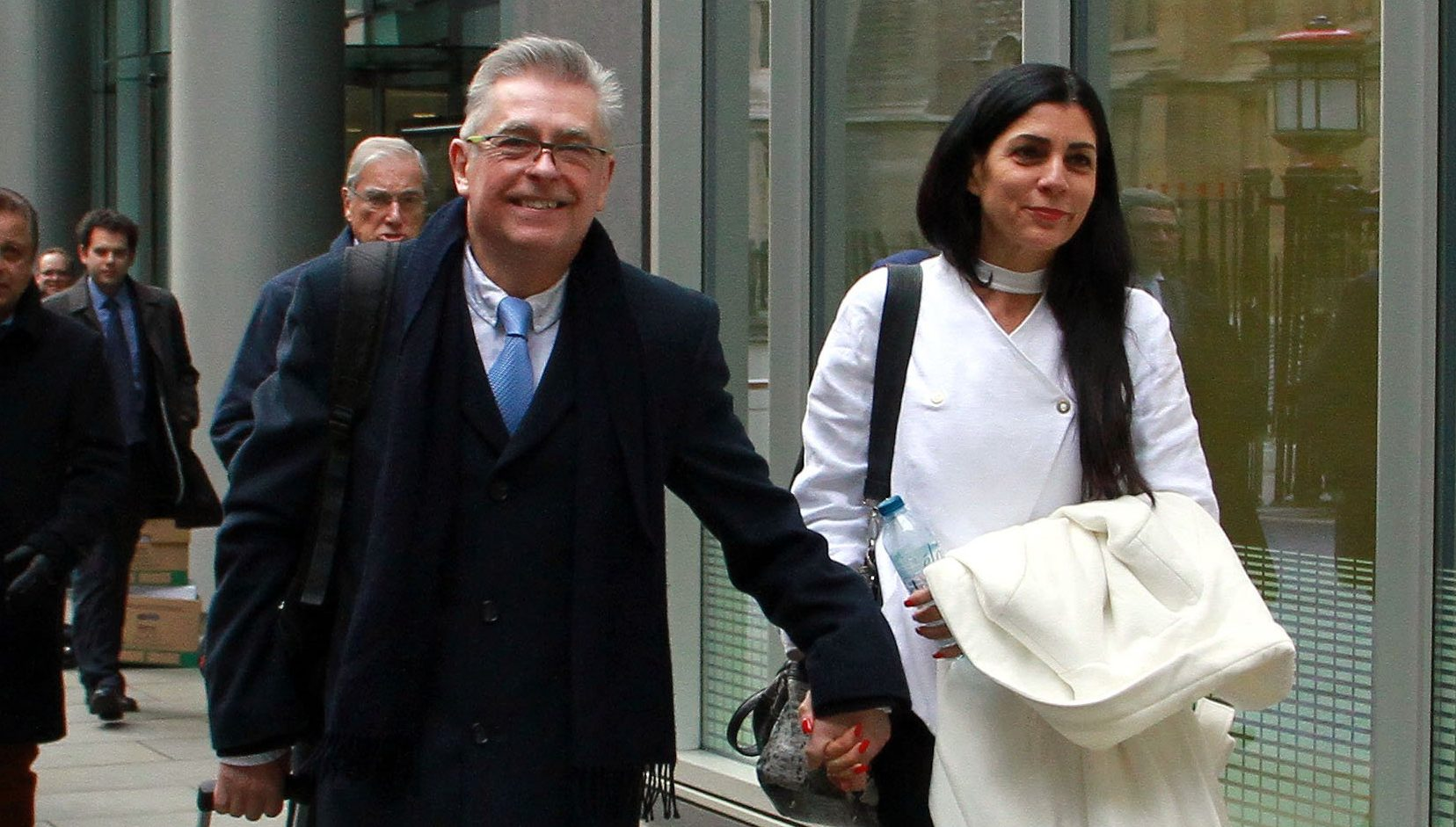 Champion News: 07948286566/07914583378 news@championnews.co.uk Picture shows former BA captain Chris Burgess and wife Cleide Burgess outside the High Court in London.