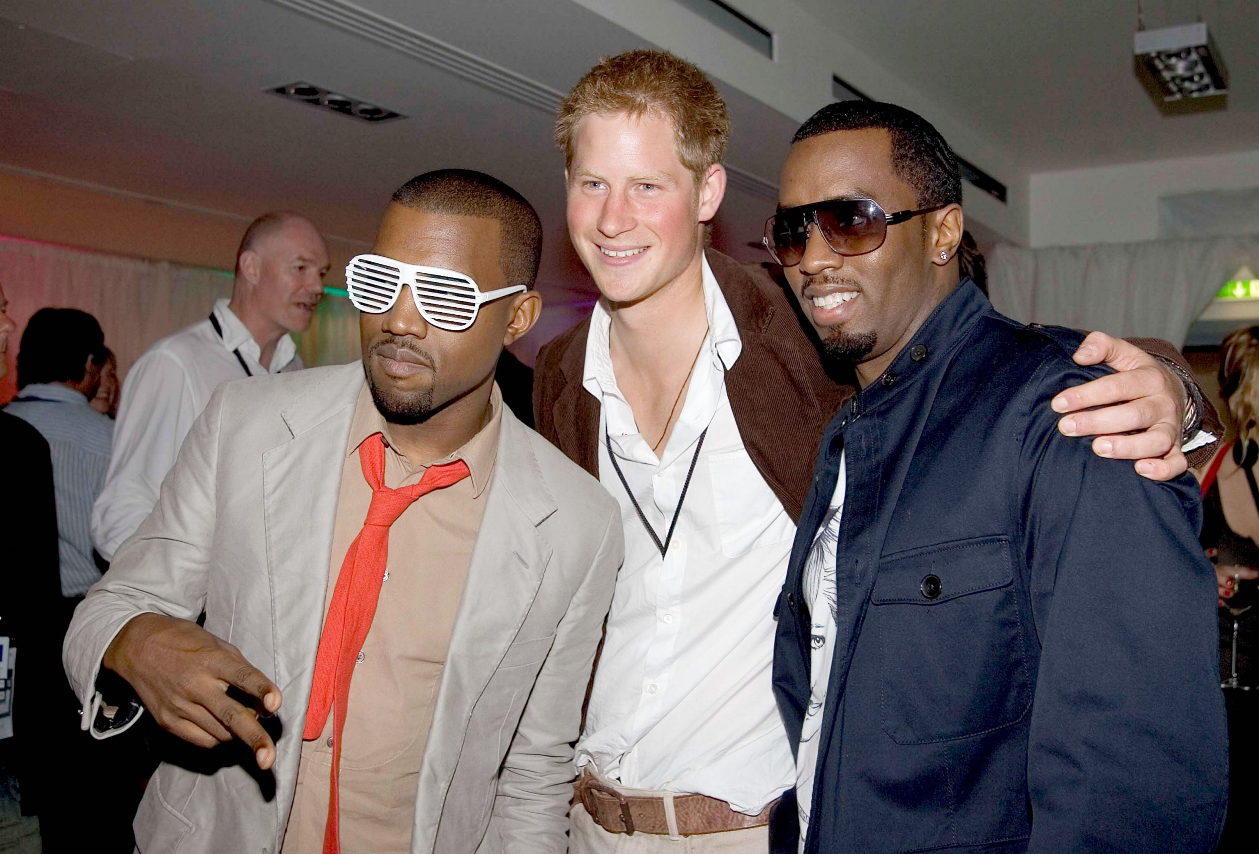 LONDON, ENGLAND - JULY 1: (NO PUBLICATION IN UK MEDIA FOR 28 DAYS) Prince Harry poses for a photograph with P Diddy and Kanye West at the after concert party the Princes hosted to thank all who took part in the 'Concert for Diana' at Wembley Stadium which the Princes organised to celebrate the life of their mother, Diana Princess of Wales, July 1, 2007 in London, England. (Photo by POOL/ Tim Graham Picture Library/Getty Images)
