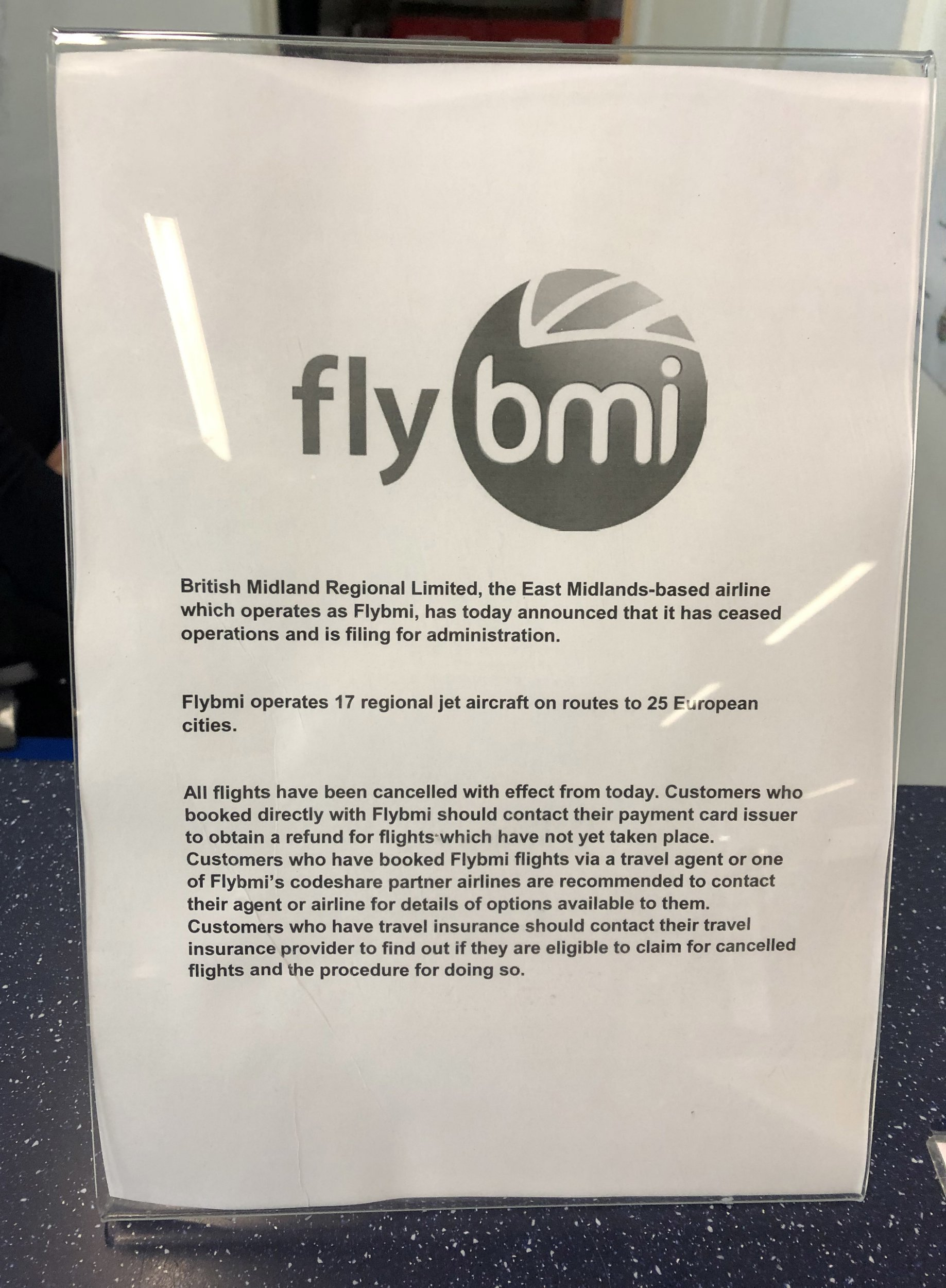 A notice at Bristol Airport informing passengers that flybmi flights have been cancelled following the collapse of the airline. PRESS ASSOCIATION Photo. Picture date: Sunday February 17, 2019. British Midland Regional Limited, which operated as flybmi, announced on Saturday evening that it was filing for administration. See PA story AIR FlyBMI. Photo credit should read: PA Wire
