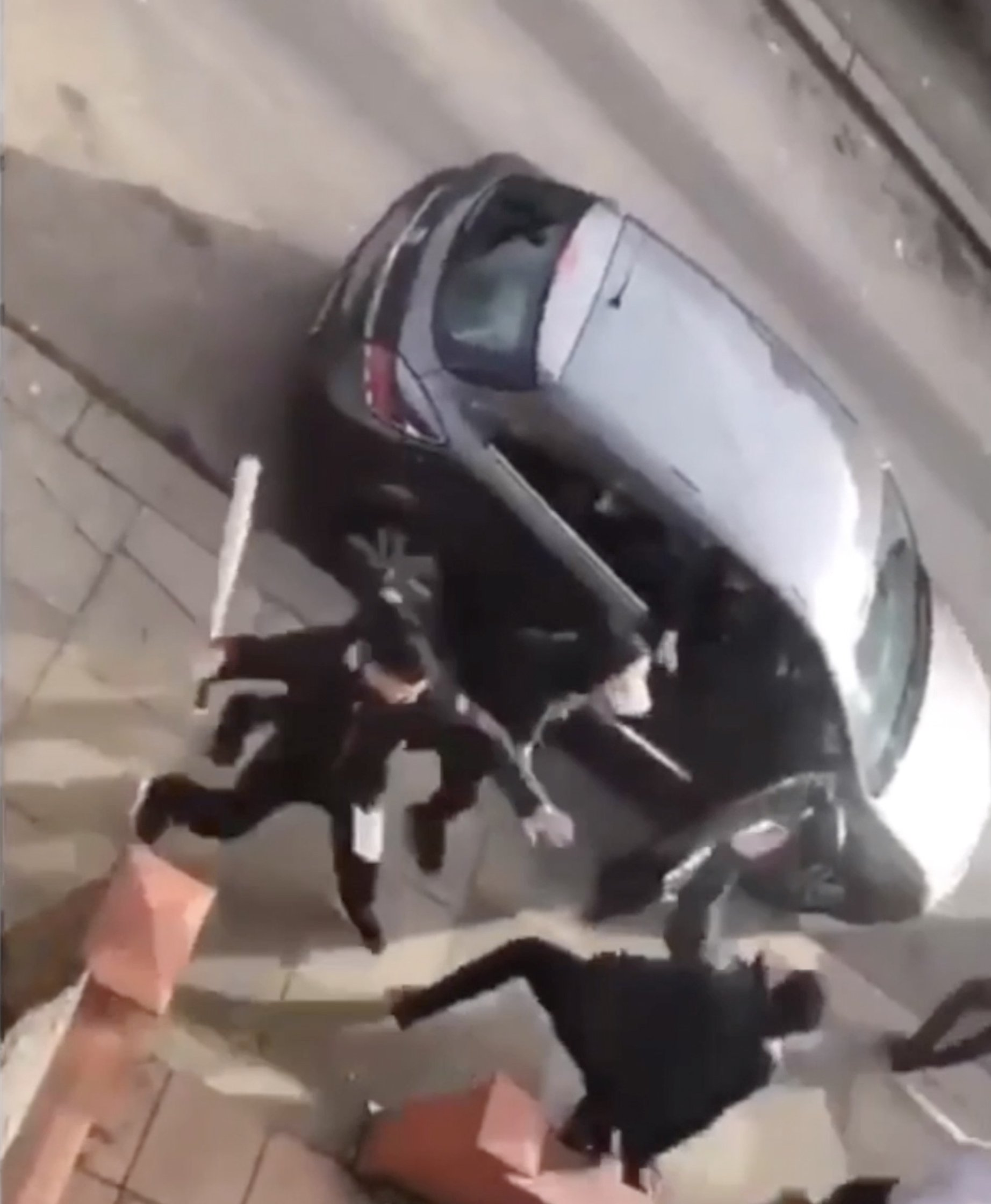 A baseball bat is swung in the direction of one of a young man's head which it connects with, Luton, Bedfordshire, filmed last week (February 2019). THIS is the moment a violent mass brawl erupted between five men on a residential street in Luton ? which ends in one male beating another with a BASEBALL BAT. The men can be seen aggressively fighting each other on Saxon Road in Luton ? the same street that hit headlines in September when gangs armed with baseball bats clashed and left a teenager fighting for his life. In the shocking clip, a terrified woman can be seen desperately screaming for the police in a parked car ? whilst a thug repeatedly bashes another man in the head with a baseball bat on the residential street. The incident is believed to have taken place last week. It is unknown why the fight took place but the footage has been shared across social media. ... SEE COPY AND VID ... PIC BY NEWS DOG MEDIA ... 0121 517 0019