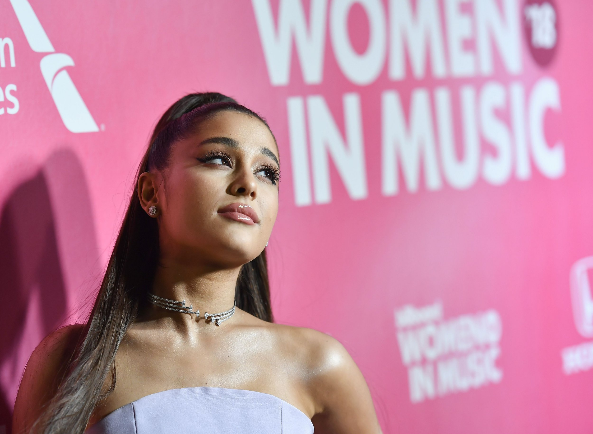 "(FILES) In this file photo taken on December 6, 2018 US singer/songwriter Ariana Grande attends Billboard's 13th Annual Women In Music event at Pier 36 in New York City. - Pop princess Ariana Grande is the first act in more than 50 years to claim simultaneously the top three spots on the US singles chart, industry tracker Billboard said February 18, 2019. The 25-year-old star is the second act in the Billboard Hot 100 chart's six-decade history to accomplish the feat, after The Beatles in 1964.Grande's ""7 Rings,"" ""Break Up With Your Girlfriend, I'm Bored"" and ""Thank U, Next"" monopolized the top hits chart following her fifth album's debut on Billboard's top albums tally. (Photo by Angela Weiss / AFP)ANGELA WEISS/AFP/Getty Images"