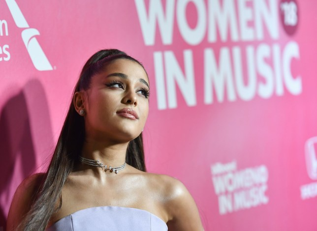 """(FILES) In this file photo taken on December 6, 2018 US singer/songwriter Ariana Grande attends Billboard's 13th Annual Women In Music event at Pier 36 in New York City. - Pop princess Ariana Grande is the first act in more than 50 years to claim simultaneously the top three spots on the US singles chart, industry tracker Billboard said February 18, 2019. The 25-year-old star is the second act in the Billboard Hot 100 chart's six-decade history to accomplish the feat, after The Beatles in 1964.Grande's """"7 Rings,"""" """"Break Up With Your Girlfriend, I'm Bored"""" and """"Thank U, Next"""" monopolized the top hits chart following her fifth album's debut on Billboard's top albums tally. (Photo by Angela Weiss / AFP)ANGELA WEISS/AFP/Getty Images"""