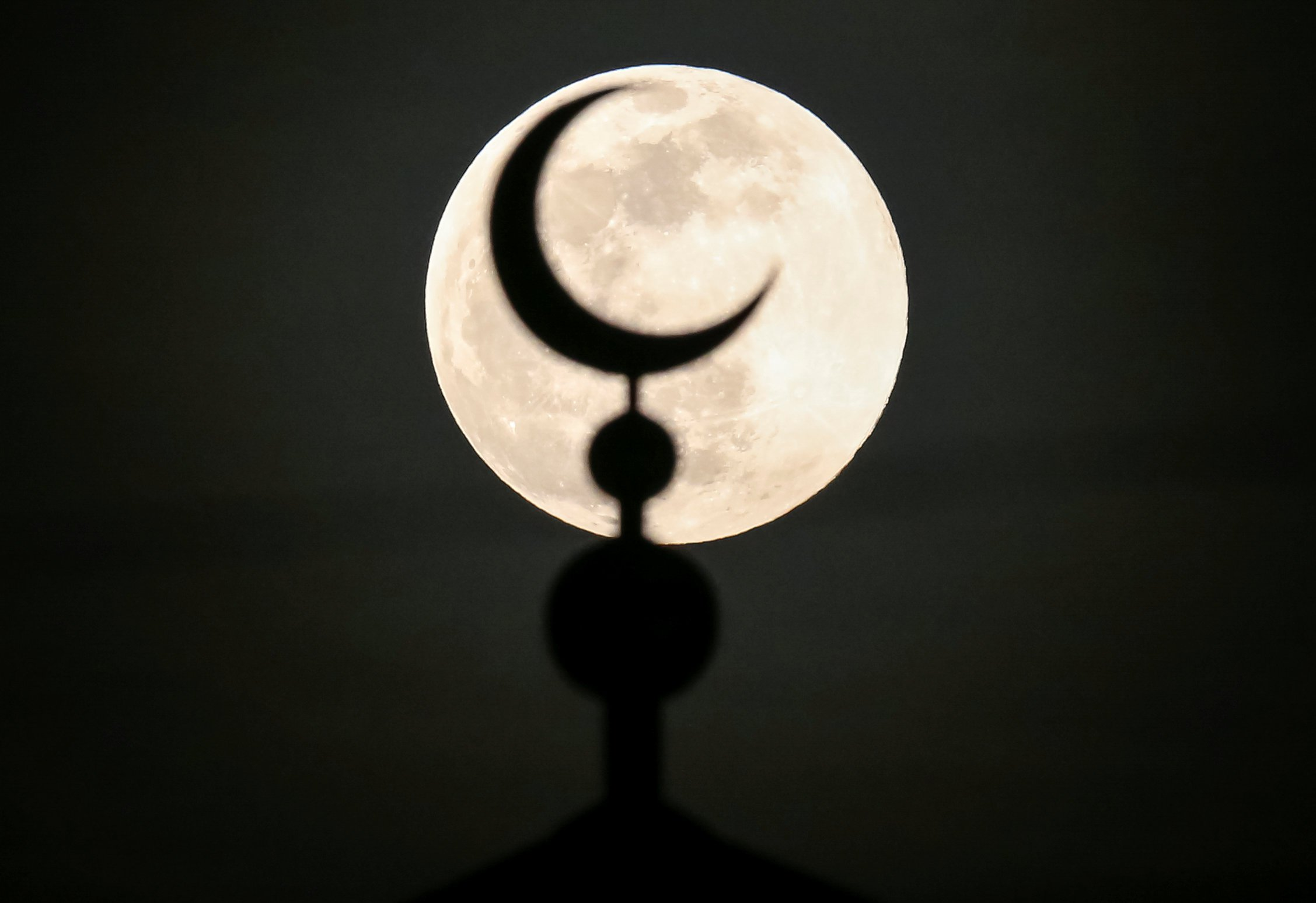 The Moon Seen Behind A Mosque