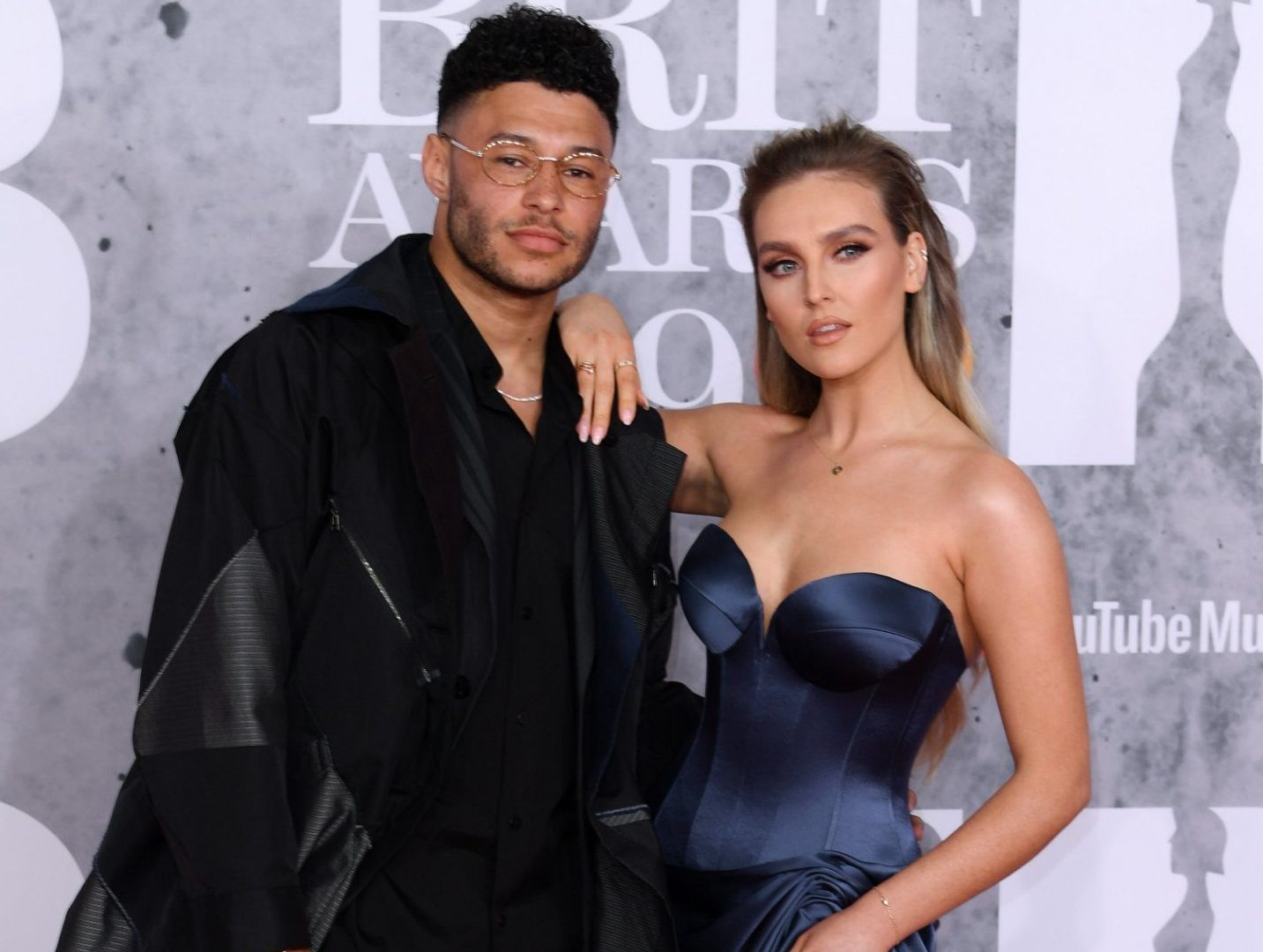 Mandatory Credit: Photo by David Fisher/REX (10110752eg) Alex Oxlade-Chamberlain and Perrie Edwards 39th Brit Awards, Arrivals, The O2 Arena, London, UK - 20 Feb 2019