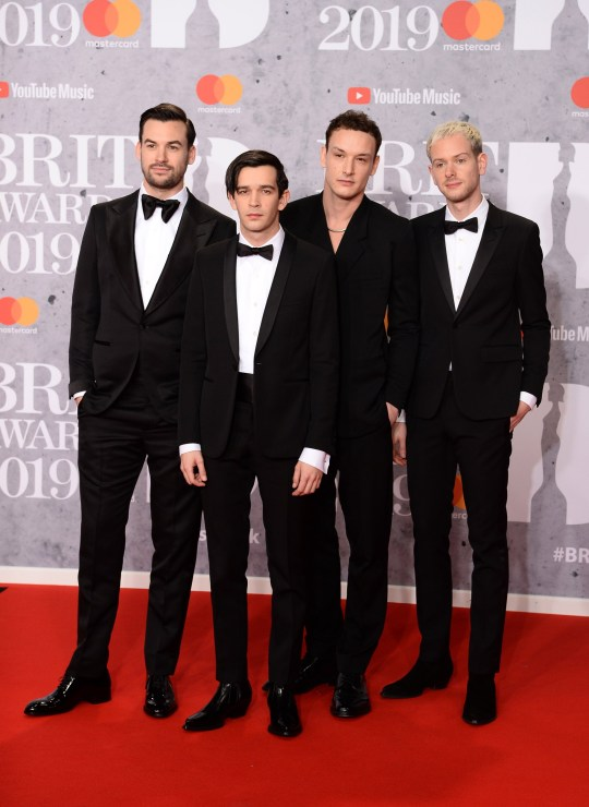 LONDON, ENGLAND - FEBRUARY 20: Ross MacDonald, Matthew Healy, George Daniel and Adam Hann from 1975 attend The BRIT Awards 2019 held at The O2 Arena on February 20, 2019 in London, England. (Photo by Jeff Spicer/Getty Images)