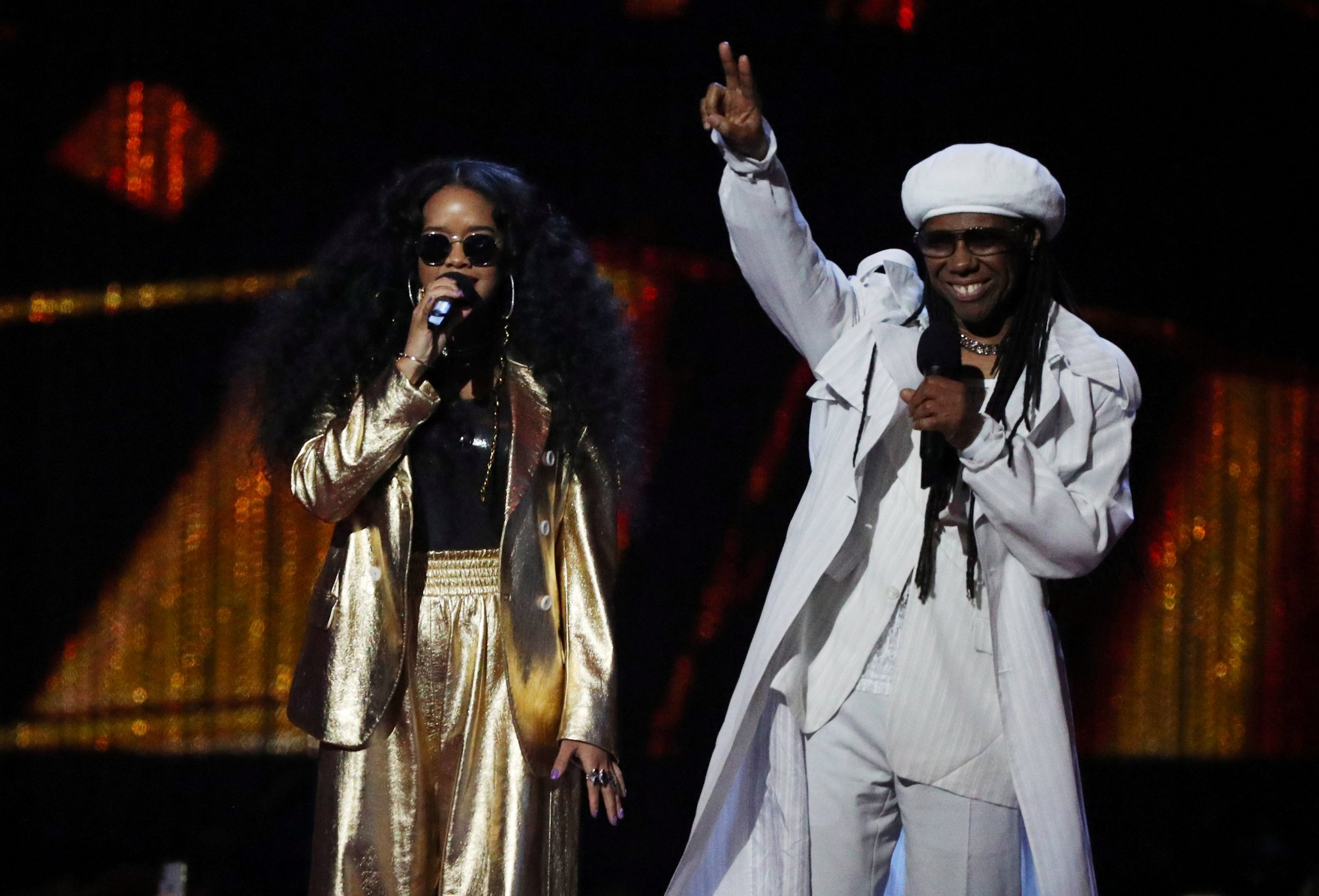 Nile Rodgers almost says 'breast' instead of 'best' in awkward slip up while presenting an award at the Brits