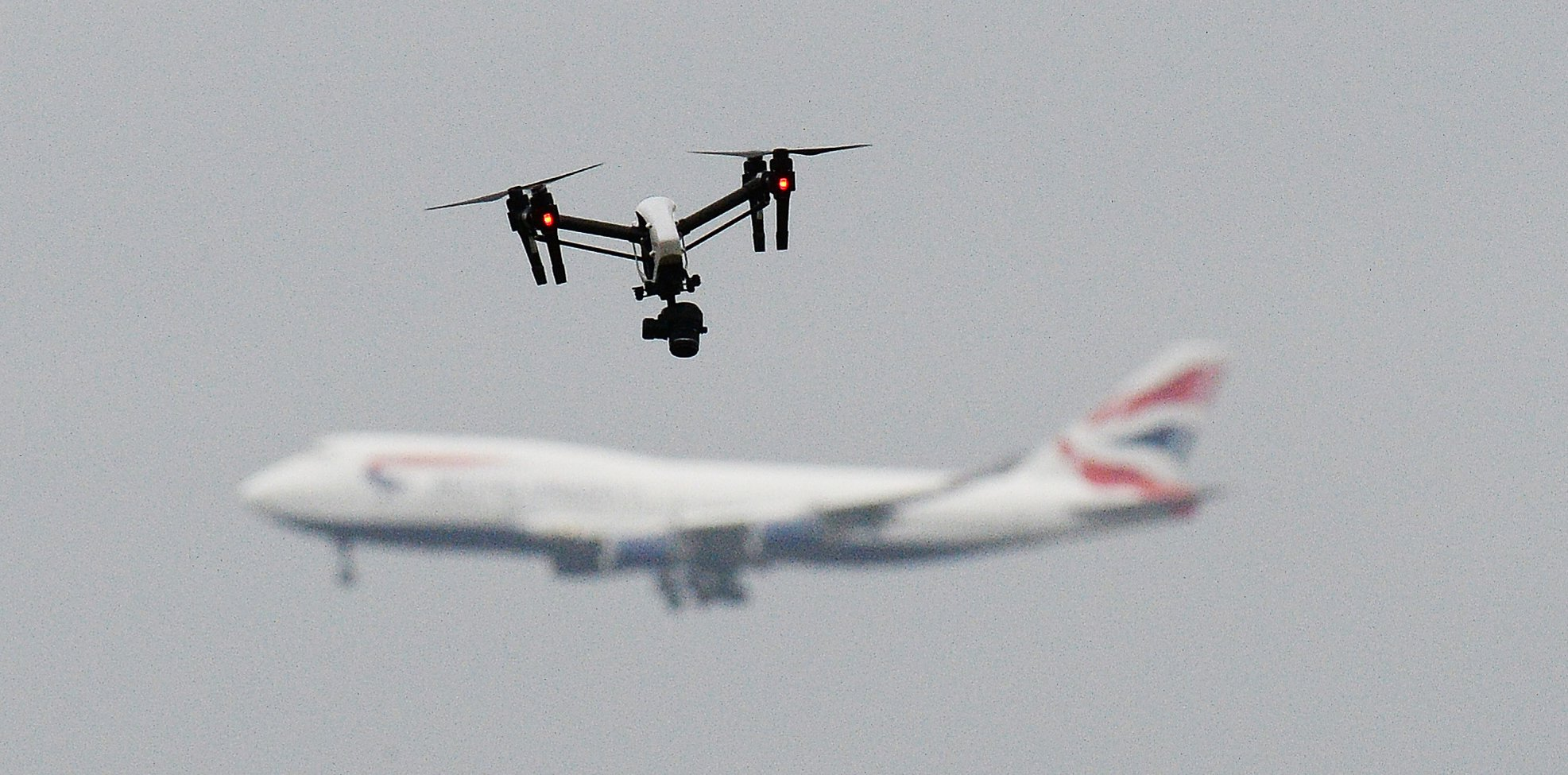 """The drone attack that brought Gatwick to a standstill before Christmas is believed to have been an """"inside job"""", according to Whitehall sources FILE PHOTO dated 25/2/2017 of a drone and an aircraft. Gatwick airport remains closed this morning after drones were spotted over the airfield last night and this morning."""