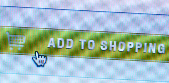 Tax for online shopping BERLIN, GERMANY - AUGUST 11: This photo illustration shows a button with the writing ' add to shopping ' on the website of an online shopping store on August 11, 2015 in Berlin, Germany. (Photo by Thomas Trutschel/Photothek via Getty Images)