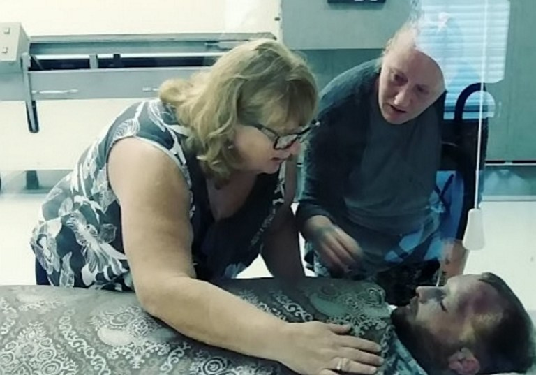 """Collect of Nora identifying Andrew's body in the morgue after his overdose October 2018.Andrew Jugler, 29, died from a drug overdose in October 2018 and now his mother Nora Sheehan, 56, is hoping to raise awareness of the challenges drug addicts face.Rehoboth Beach, Delaware. See SWNS story SWNYloss. .This is the tragic moment a mother held her son for the last time as she identified his body following a fatal drug overdose.Nora Sheehan, 56, lost her son Andrew Jugler, 29, in October after he took a deadly dose of xylazine and fentanyl, following an eight year battle with addiction.""""Holding my dead son in my arms, this is the picture of addiction. This is what happens,"""" said Nora, who is sharing the image to create stark awareness of the opioid crisis. The grieving mom, of Rehoboth Beach, Delaware, said Andrew?s addiction began with oxycontin painkillers in 2010 and gradually progressed to heroin and fentanyl."""