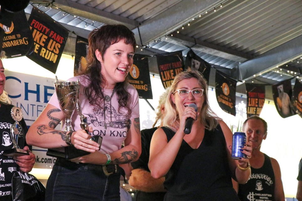 Pic by Jack Antcliff/Caters News - (Pictured: Mulletfest winner Michelle Gearin, takes her prize at the second annual Mullet festival in Kurri Kurri, NSW, Australia. Pic taken 23/02/2019) - An Aussie town was transformed as competitors turned out for the second annual Mulletfest - celebrating the most iconic of eighties hairdos. Coiffed individuals from across Australia gathered in the Chelmsford Hotel in the rural town of Kurri Kurri to celebrate the infamous business at the front, party at the back hairstyle. Men and women competed in five categories - the everyday mullet, grubby mullet, ranga mullet , ladies mullet and junior mullet in the hope of being crowned a winner in the style stakes. The festival was launched by hairdresser Laura Johnson last year attracting more than 150 entrants. ENDS