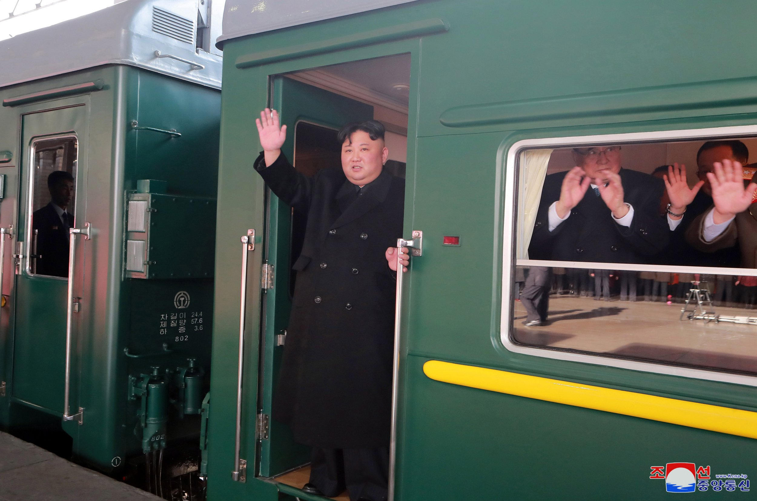 Kim Jong-un waves as he sets off for second meeting with Donald Trump