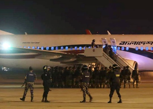 epa07393037 Police forces surround the hijacked Dubai-bound Bangladesh Biman Boeing 737-800 plane on the tarmac after an emergency landing at the Shah Amanat International Airport in Chittagong, Bangladesh, 24 February 2019. According to the local media report national flag carrier bound for Dubai made an emergency landing and the passengers safely evacuated. A suspect has been arrested in the hijacking of a Biman Bangladesh Airlines plane at Chattogram's Shah Amanat International Airport. EPA/STR BEST QUALITY AVAILABLE