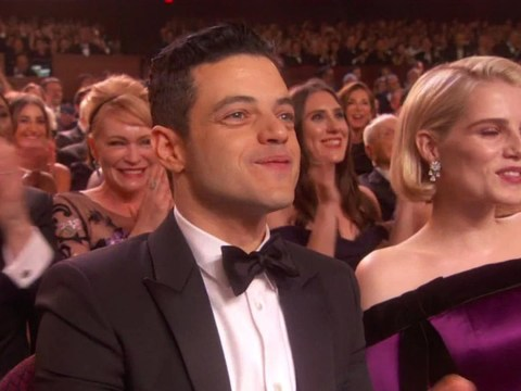 Queen and Adam Lambert get Rami Malek dancing in his seat as they kick off Oscars 2019