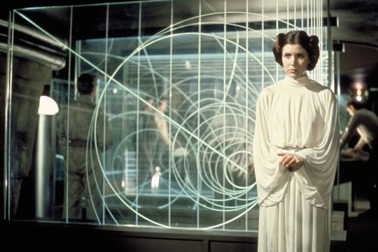 Editorial use only. No book cover usage. Mandatory Credit: Photo by Lucasfilm/Fox/Kobal/REX/Shutterstock (5886297dn) Carrie Fisher Star Wars Episode IV - A New Hope - 1977 Director: George Lucas Lucasfilm/20th Century Fox USA Scene Still Scifi Star Wars (1977) La Guerre des ?toiles