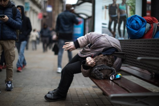 Mandatory Credit: Photo by Joel Goodman/Lnp/REX/Shutterstock (8588267af) A man with a pipe in his hand lies slumped on a bench in front of Morrisons Supermarket in Piccadilly Gardens . An epidemic of abuse of the drug spice by some of Manchester's homeless population , in plain sight , is causing users to experience psychosis and a zombie-like state and is daily being witnessed in the Piccadilly Gardens area of Manchester , drawing large resource from paramedic services in the city centre . Spice Epidemic in Manchester, UK - 06 Apr 2017