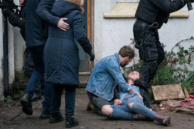 David cradles Shona after a Coronation Street stabbing