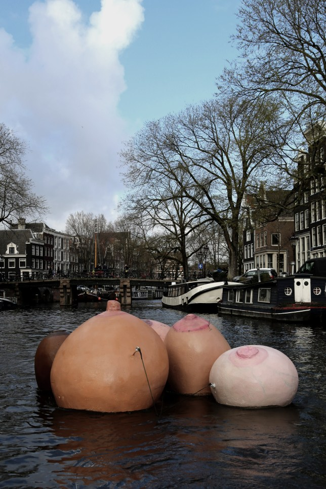 Inflatable breasts on a canal in Amsterdam