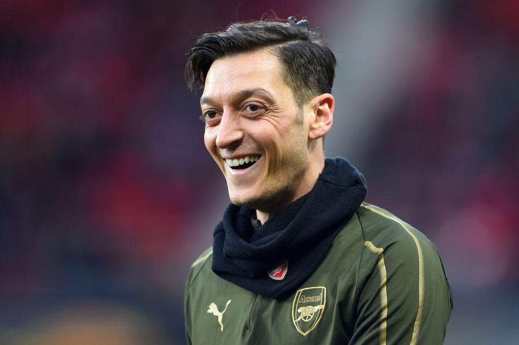 Robert Pires compares 'magician' Mesut Ozil to Arsenal legend Dennis Bergkamp